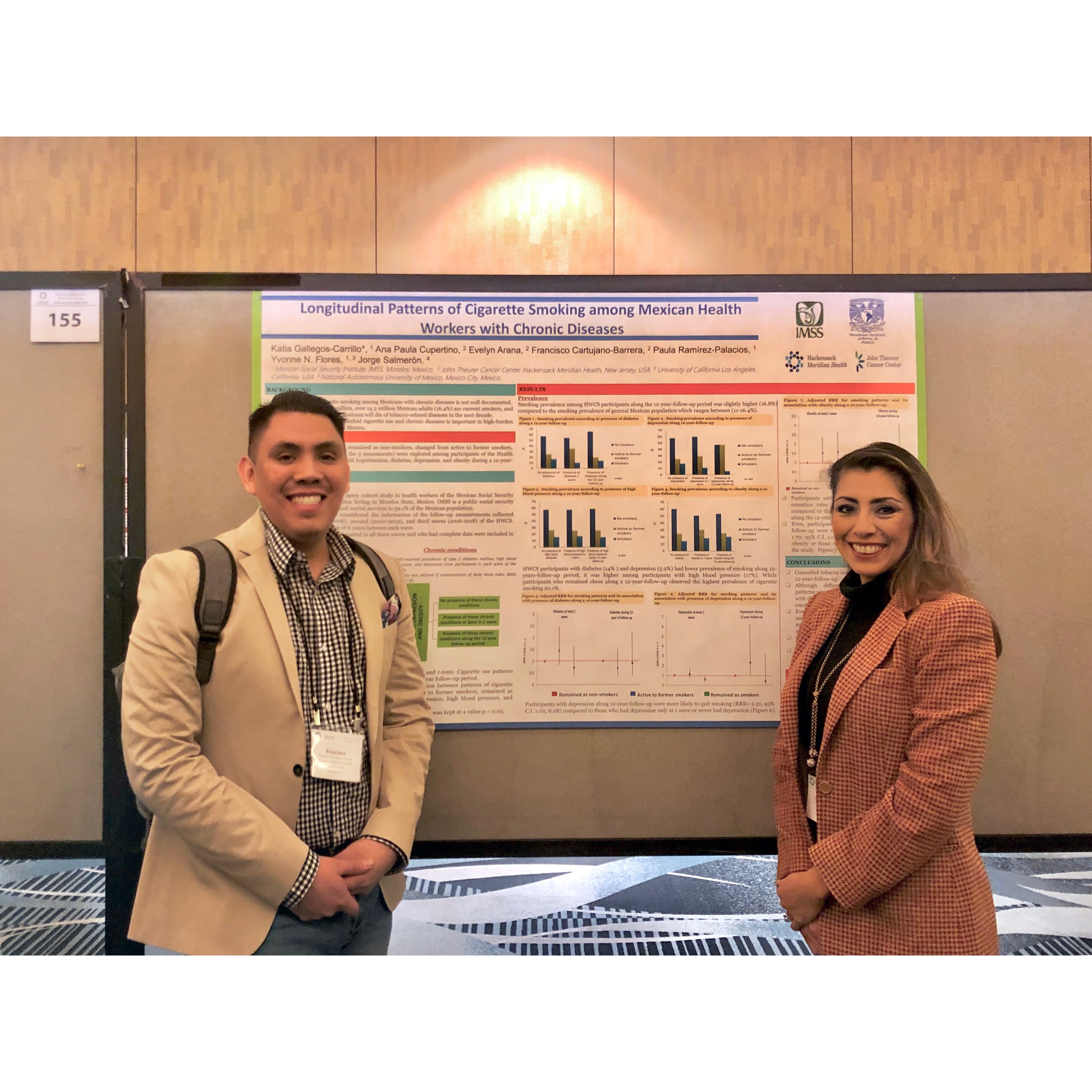 """Drs. Cartujano-Barrera and Gallegos presenting """"Longitudinal Patterns of Cigarette Smoking among Mexican Health Workers with Chronic Diseases"""" at the 2019 Society for Research on Nicotine & Tobacco Annual Meeting."""